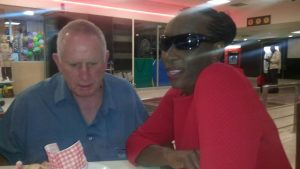 John shows Nosisa Apple's iPhone that caters for the blind
